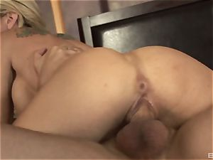 light-haired cougar with giant fake hooters Sarah Jessie