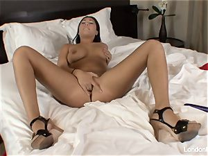 Pierced asian London Keyes plays with her vag in sofa
