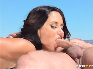 Ava Addams taking two huge stiffys at once
